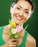 Happy asian girl with tulips royalty free stock photo