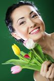 Happy asian girl with  tulips Royalty Free Stock Image