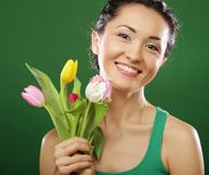 Happy asian girl with tulips stock image