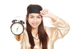 Happy Asian girl  wake up early morning show alarm clock Stock Photos