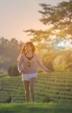 Happy asian girl walk on grass in sunny day. stock photography