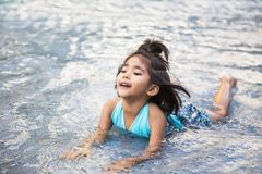 Happy asian girl on pool. Happy asian girl on water Royalty Free Stock Photo
