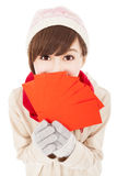 Happy asian girl with winter wear. And holding  red bag for  chinese new year Royalty Free Stock Photos
