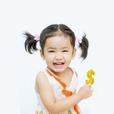 Happy  asian girls with dollar in hand on the white background Royalty Free Stock Photos
