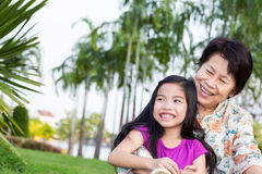 Happy asian grandma and grandchild smiling. In park royalty free stock photography