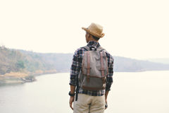 Happy Asian hipster man backpack in nature background royalty free stock photos