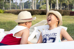 Happy asian kid enjoy summer vacation royalty free stock photos