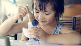 Happy asian kid enjoys ice cream stock footage