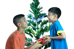 Happy Asian kid give present to his brother Royalty Free Stock Photo