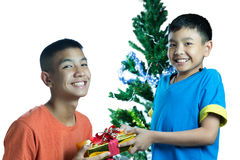 Happy Asian kid give present to his brother Stock Photography