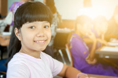 Happy Asian kid smiling. In classroom Royalty Free Stock Photos