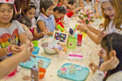 Happy Asian kids enjoying handcraft activities Royalty Free Stock Photo