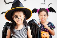 Happy asian little child girl having fun on Halloween celebration Royalty Free Stock Photography