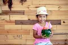 Happy asian little girl is holding watermelon blended juice Royalty Free Stock Photos