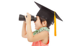 Happy asian Little girl looking through binoculars Royalty Free Stock Photo