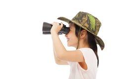 Happy asian Little girl looking through binoculars. Stock Image