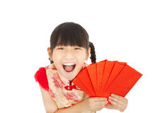 Happy asian little girl showing red envelope Stock Photography