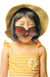 Happy asian little girl in swimsuit ,sunglasses and sun hat on w Stock Photos