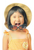 Happy asian little girl in swimsuit ,sunglasses and sun hat on w Royalty Free Stock Image
