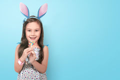 Happy asian little girl wearing bunny ears on easter day Stock Image
