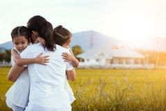 Happy asian little girls hugging mother Stock Images