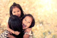 Happy asian little girls hugging mother Royalty Free Stock Images