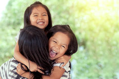 Happy asian little girls hugging mother Stock Image