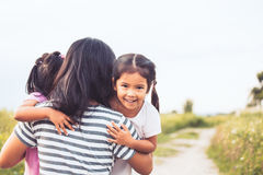 Happy asian little girls hugging mother Stock Photography
