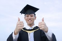 Happy asian male graduate Stock Images