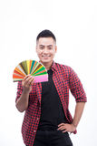 Happy asian male graphic designer holding color fan in his hand.  stock image