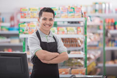 Happy asian male shopkeeper Stock Photography
