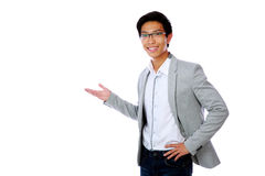 Happy asian man with arm out. In a welcoming gesture Royalty Free Stock Images
