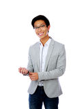 Happy asian man buttoning his jacket Royalty Free Stock Photography