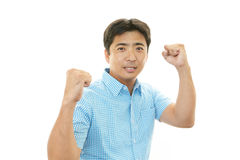 Happy Asian man cheering stock photography