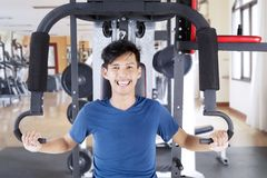 Happy asian man exercising in gym.  Royalty Free Stock Image