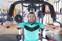 Happy asian man exercising in gym.  Stock Photography