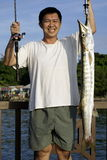 Happy asian man with fish Royalty Free Stock Photos