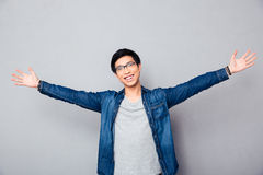 Happy asian man greeting somebody Royalty Free Stock Photography