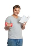 Happy Asian man hold  book and red dumbbell Stock Photography