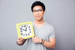 Happy asian man holding big clock Royalty Free Stock Photography