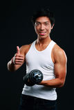 Happy asian man holding dumbbell Stock Photography