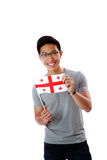 Happy asian man holding flag of Georgia Stock Images