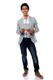 Happy asian man holding tablet computer Royalty Free Stock Image