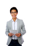 Happy asian man holding tablet computer Royalty Free Stock Photos