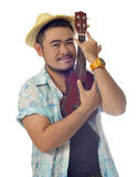 Happy Asian man hug Ukulele isolate background Royalty Free Stock Photography