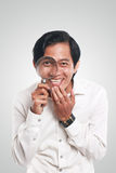 Happy Asian Man With Magnifying Glass Stock Photography