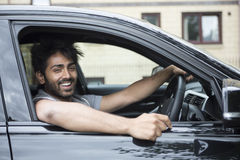 Happy Asian man in new car. Royalty Free Stock Image