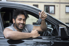 Happy Asian man in new car. Stock Images