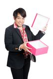 Happy Asian man open a blank gift box Royalty Free Stock Images