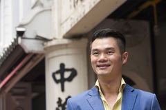 Happy Asian man out walking in the city. Stock Images
